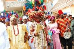 His Royal Highness, Igwe Cyprian Nevobasi, Igwe Omeluenyi 1 of Agunnese, Ezeani 111 of Nmaku Kingdom and Governor Ifeanyi Ugwuanyi of Enugu State [Photo Credit: Femi Adesina Facebook Page]
