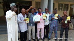 Party members show certificate issued by INEC.