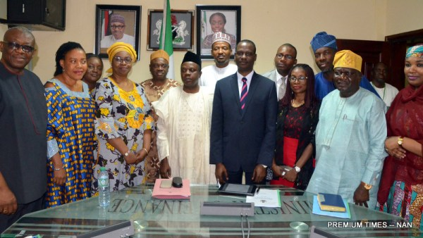 Vice-Chairman, National Tax Policy Implementation Committee (NTPIC), Mr Taiwo Oyedele (6th, R) and other committee members after submission of their report to Minister of Finance, Mrs Kemi Adeosun, in Abuja on Friday (2/2/18). The National Executive Council approved the revised National Tax Policy on Feb. 1, 2017; and as a follow-up action to the approval, Minister of Finance on April 2, 2017, constituted the NTPIC. 00648/2/2/2018/Jones Bamidele/NAN