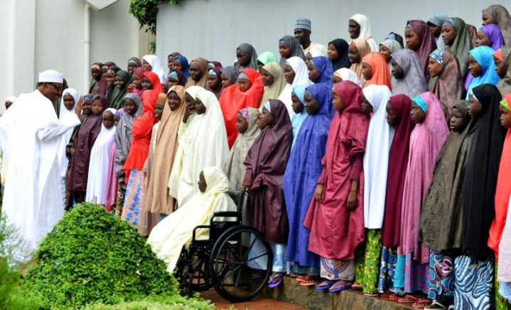 File photo of President Muhammadu Buhari (l) with the released Dapchi School Girls believed to have been adopted by Boko Haram Terrorists during a ceremony to formally receive them at the the Presidential Villa in Abuja on Friday (23/3/13) 01703/23/3/2018/Callistus Ewelike/NAN