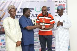 Presidential Spokesperson, Mr Femi Adesina presents award to Mallam Yusuf Alli of the Nation at the Campus Journalism Awards in Abuja while organisers, Gidado Shuaib and Yushau Shuaib look on