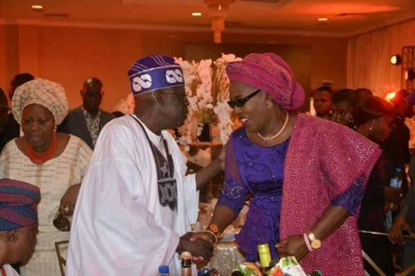 APC Chieftain Asiwaju Bola Tinubu (left), and Wife of Ondo state Governor, Chief Mrs Betty Anyanwu - Akeredolu (right), during the engagement ceremony of Efuntoun Olayinka Osoba, the daughter of former Governor of Ogun state, Chief Olusegun Osoba to Adegboyega Apata in Lagos, at weekend.