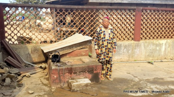 Chief Olayinka standing by the well in his compound