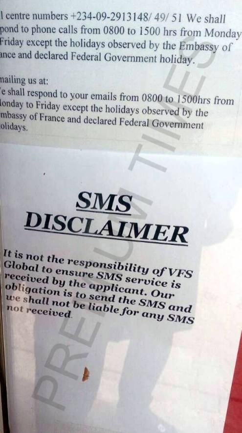 A disclaimer on the information board at VFS Abuja office. It says the company is not liable for SMS not sent.