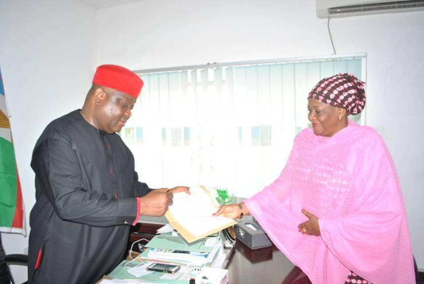 Osita Izunonso(left) receiving report from fati Balla.