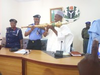 Mr Tahiru Shina Olukolu Gombe state Police Commissioner handing over the Mace to Speaker Abubakar Nasiru Nono watched by Gombe state NSCDC Commander Hajiya Altine at state Assembly conference hall