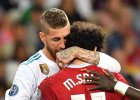 Sergio Ramos embrace Mo Salah after picking up a shoulder injury during the #UCLFinal
