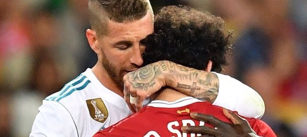 Sergio Ramos embrace Mo Salah after picking up a shoulder injury during the #UCLFinal