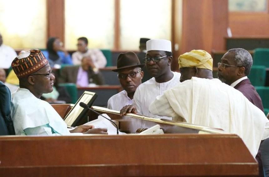Abdulmumin Jibrin confronting speaker Yakubu Dogara on 2018 budget. [Photo credit: Reps official Facebook account]