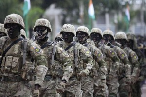 Soldiers from Ivory Coast's Special Forces march in a military parade, marking Independence day, near the presidential palace in Abidjan