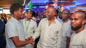 Senate President, Bukola Saraki with the Super Eagles player, Alex Iwobi