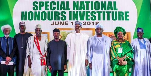 President Muhammadu Buhari; Vice President Yemi Osinbajo (1st left); Son of Late MKO Abiola, Kola Abiola (1st right); Amb. Babagana Kingibe (2nd left); Wife of Late Ganiyu Fawehinmi, Ganiyat Fawehinmi (2nd right); Sen. Asiwaju Bola Tinubu (3rd right); Sec. to the Govt. of the Federation, Boss Mustapha (3rd left); Prof. Wole Soyinka (4th left).