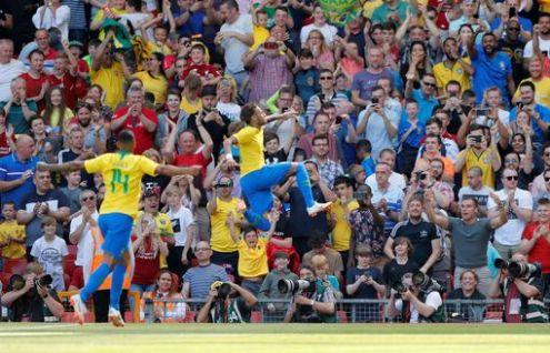 Neymar celebrates Brazil's opening goal against Croatia at Anfield.