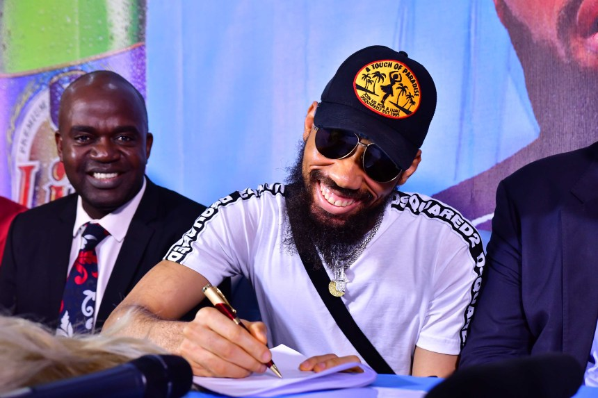 Phyno signing a business deal with Life Lager beer