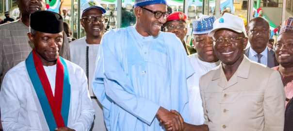 President Muhammadu Buhari (M) congratulating the Newly elected National Chairman of APC, Comrade Adams Oshiomhole (R) While Vice President Yemi Osinbajo looks on during the closing ceremony of the party's 2018 National Convention at the Eagles Square Abuja on Sunday (24/6/18) 03376//24/6/2018/ICE/NAN