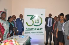 The Chairman and Executive Director flanked by staff of LFN with the #LFNat30 logo (2)