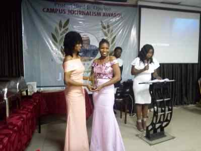 Chiamaka Okafor receiving the award for best community journalism story.