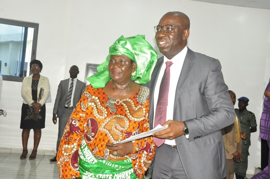 Gov Godwin Obaseki with the Market Women Association leader, Madam Blackie Ogiamien, during a courtesy visit by traders to the governor at the Government House