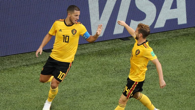 Hazard celebrates with team mate after scoring the second of the game