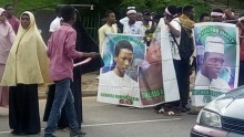 Shiite members protesting with pictures of their members that have died