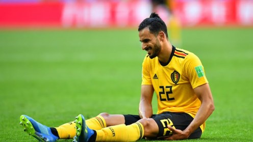 Nacer Chadli appears injured while play is temporary halted [Photo: Reuters]