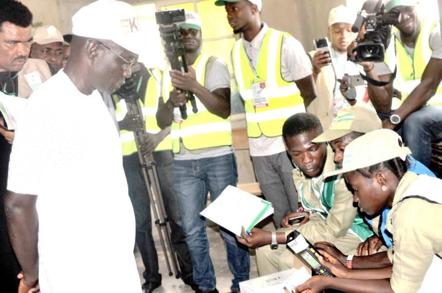 PDP Candidate for the July 14th Ekiti State Governorship Election, Prof. Olusola Eleka (L) waiting to be accredited at Ward 2 Unit 7, Okeruku, Ikere Ekiti during the Governorship Election in Ekiti on Saturday (14/7/18). 03768/14/7/2018/Timothy Adeogodiran/ICE/NAN