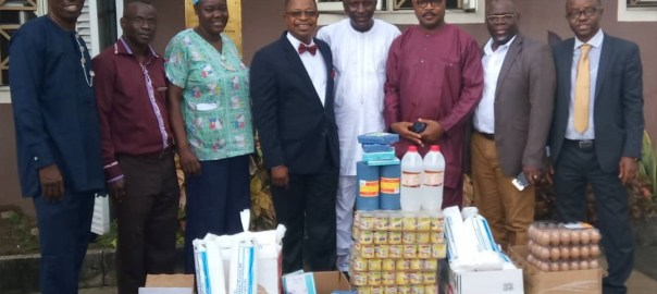 The Club's President, Mr. Tunde Thani, (4th from left), some members of the club and the hospital staff during the presentation of the relief materials.