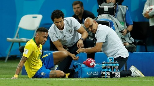 Neymar being treated on the sidelines (Photo Credit: Reuters)