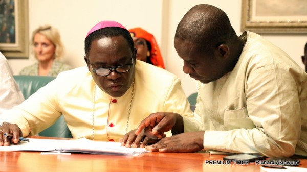 Bishop Matthew Kukah with PREMIUM TIMES' Editor-in-Chief, Mojeed Musikiliu