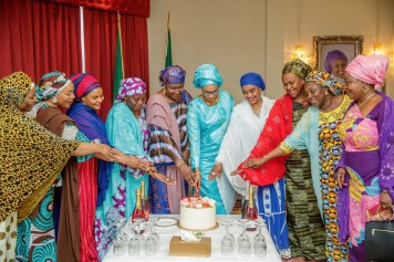 Cutting the birthday cake at the Presidential Villa