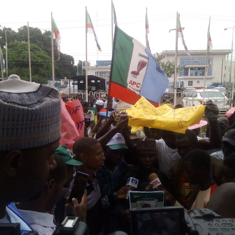 Caption Haruna Maikano speaking at the rally against Saraki