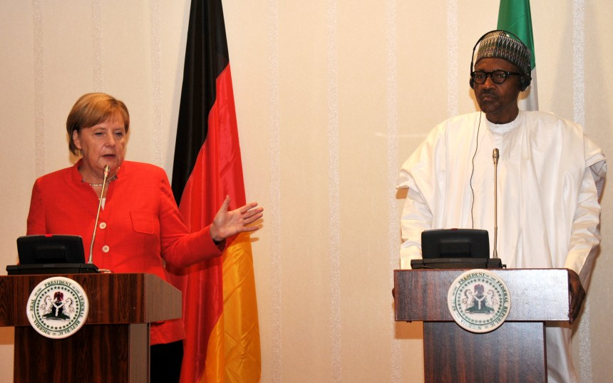 President Muhammadu Buhari (R) addressing a joint News Conference with the visiting German Chancellor, Angela Merkel at the Presidential Villa in Abuja on Friday (21/8/2018)