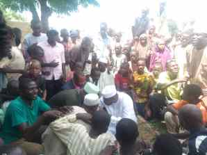 Tired of standing, Mr Ahmadu takes shield under a tree