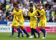 Chelsea players celebrate after scoring a goal