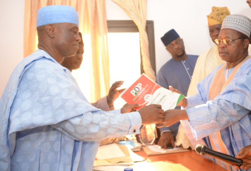 Chairman, Peoples Democratic Party (PDP) Elders Forum, Kwara South, Alhaji Kola Yusuf (right), submitting senatorial nomination form on behalf of Kwara State Governor, Dr Abdulfatah Ahmed to the State Chairman, PDP, Engineer Kola Shittu at party secretariat, Ilorin.......Tuesday