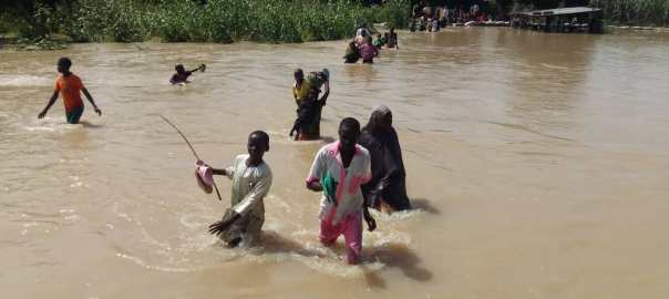 Residents crossing over at Gululu community at Jahun LGA Jigawa state