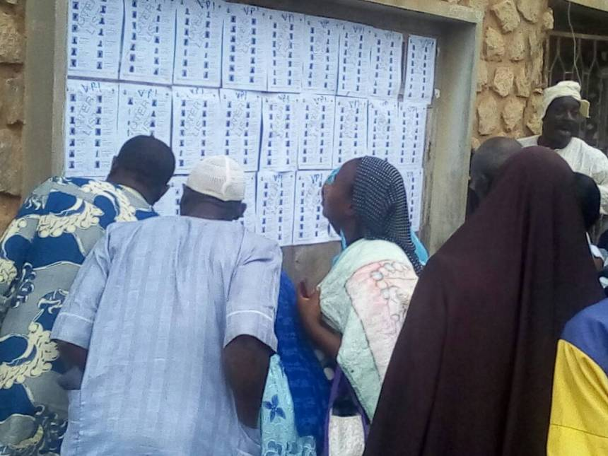 Voters checking their names in PU 4 ward 5, Oshogbo.