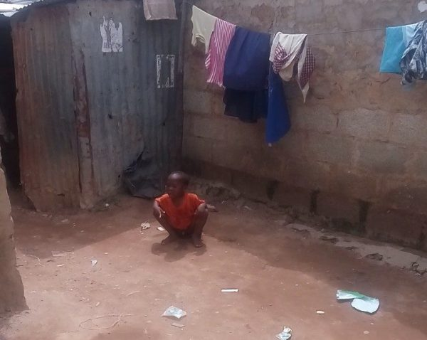 Child defecating around a living environment in Abuja
