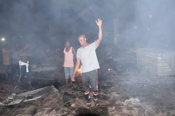 People walking through the scene of the fire incident at Fruit and Vegetable Market, Port Harcourt