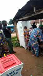 8:42am, At PU 002, Town Hall I, Iwo-Oke I, Ola-Oluwa Local government, a child called by an old man assisting to vote at the Cubicle.