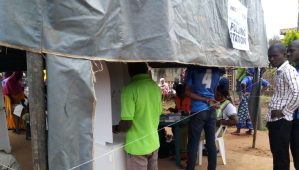 "EJIGBO: 11:30am - it was observed that voters no longer fold their ballot papers before voting at Ward 3, PU6 in front of Ejigbo local government secretariat located inside Ejigbo town. INEC Ad-hoc staff there said they have told voters to do so. ""We repeatedly told them to fold their ballot papers but they keep opening it before going to the voting cubicle. Their party agents also enlightened them on this"", an Ad-hoc staff said. It was also observed at same unit that the voter can be fully seen inside the voting cubicle as he/she votes. As part of measures to check vote buying, INEC had said it would restrategize the voting cubicle in such a way that a voter could not be seen by anybody while thumbprinting inside the cubicle. The commission also said voters will not be allowed to go in or come out from the cubicle without folding their ballot papers unlike what is currently happening in Ejigbo."