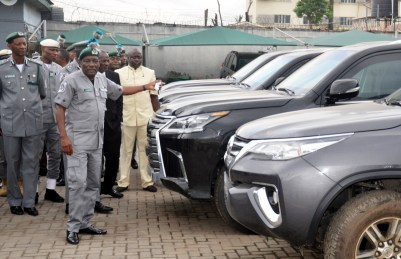 Pic.8. Controller, Federal Operations Unit, Zone A, Ikeja, Nigeria Customs Service, Mr Aliyu Mohammed (R), showing to newsmen seized smuggled nine bulletproof vehicles including 4 Lexus Jeep, in Lagos on Thursday (4/10/18). 5369/4/10/2018/Wasiu Zubair/JAU/NAN