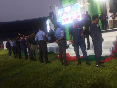 Security agents are mounting the podium, where the ballots are being sorted1