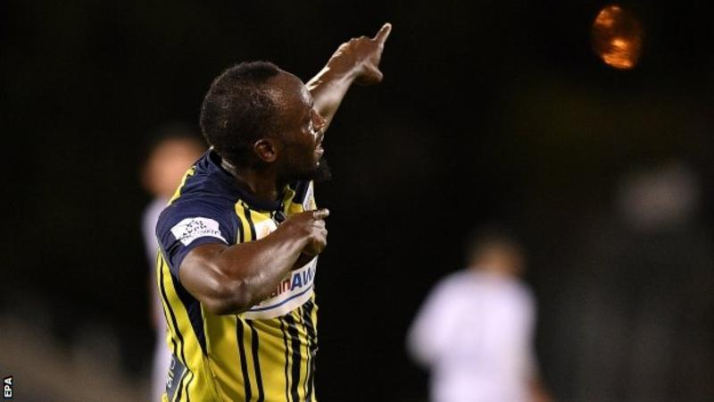 Usain Bolt celebrates after scoring