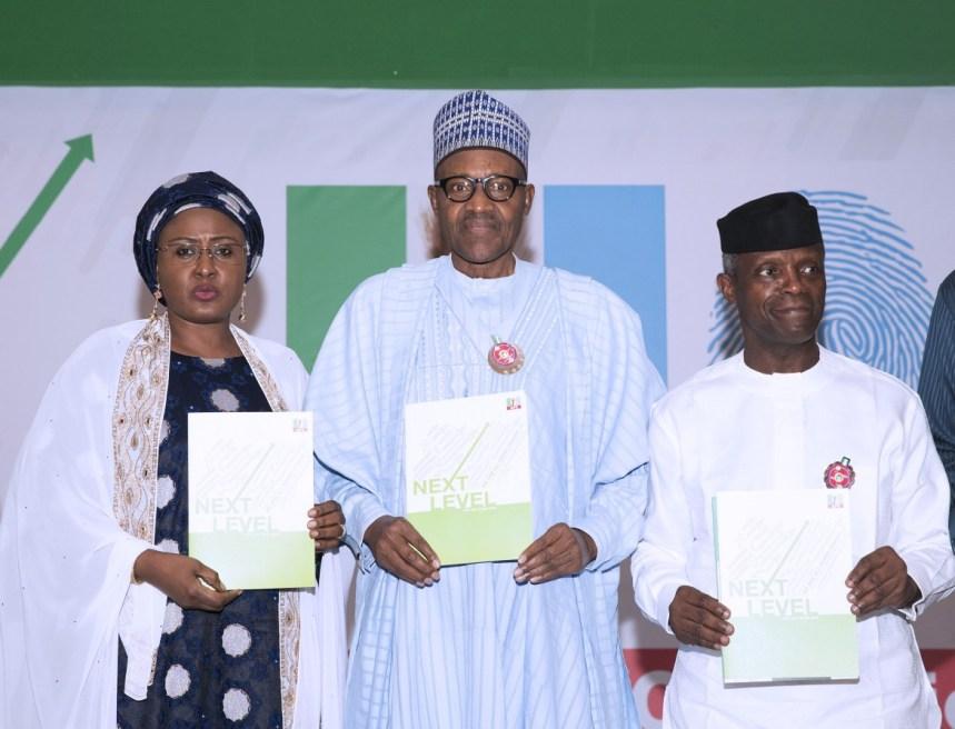 PRESIDENT BUHARI ATTENDS NEXT LEVEL 1A. President Muhammadu Buhari, Wife, Aisha and Vice President Yemi Osinbajo at the launch of Next level a scorecard of Buhari/Osinbajo at the State House Abuja. PHOTO; SUNDAY AGHAEZE. NOV 18 2018.