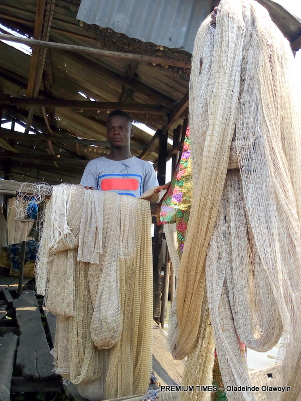Fishing net repairers in Makoko