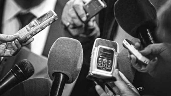 Pictures of Nigerian journalists interviewing someone [Photo: The Standard]
