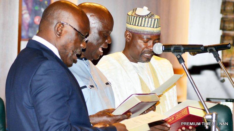 From left: Members of the Code of Conduct Bureau: Mr Ubolo Okpanachi; Mr Emmanuel Atta and Mr Murtala Kankia taking Oath of Office before President Muhammadu Buhari during the Federal Executive Council Meeting at the Presidential Villa in Abuja on Wednesday (7/11/18) 05583/07/11/2018/Callistus Ewelike/NAN
