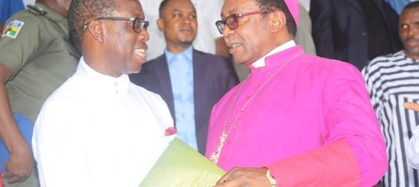 Delta State Governor, Senator Ifeanyi Okowa (left) and Archbishop of Enugu Diocese, Most Rev. Emmanuel Chukwuma, during the CAN Day Celebration, at Oleh Township Stadium, Delta State. PIX; JIBUNOR SAMUEL.