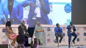 Panelist speaking on stage.